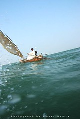 Boatman, Keenjhar Lake (Ameer Hamza) Tags: trip travel blue pakistan lake man classic water wonderful asia shot angle fine floating excellent pakistani float midday sind wanderer sindhi keenjhar