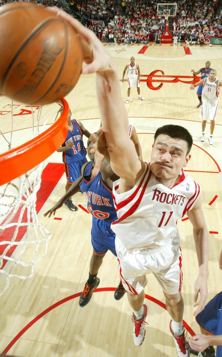 Yao Ming goes up for a dunk over the New York Knicks' David Lee on Saturday night.  Yao was dominant, finishing with 30 points, 8 rebounds, 6 assists and 4 blocks in a 103-91 win.  Aaron Brooks was also incredible, scoring 22 points on 8-of-10 shooting and amazing everyone with his speed and three-point shooting.