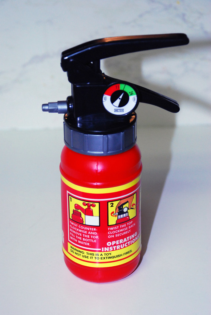 "Warning labels for idiots: ""The house is on fire, quick, grab our son's pretend fire extinguisher!"""