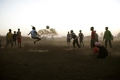 Children playing football in Mabopane, Pretoria (IFRC) Tags: africa playing children southafrica football redcross 2007