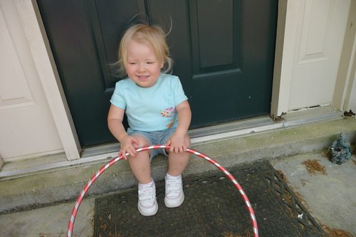Sitting on doorstep with hula hoop
