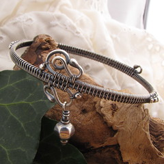 bangle east~handmade sterling silver wire wrapped bracelet (ErikaLyn~GRJ &Cu29) Tags: asian wire handmade unique wrapped jewelry east jewellery trendy bracelet rockabilly artdeco bangle lantern hip jewelery oriental bohemian artisan alternative gravelroad jewellry oxidized sterlingsilver bonnieblue wirewrapped wirejewelry hobochic gravelroadjewelry bangleeast