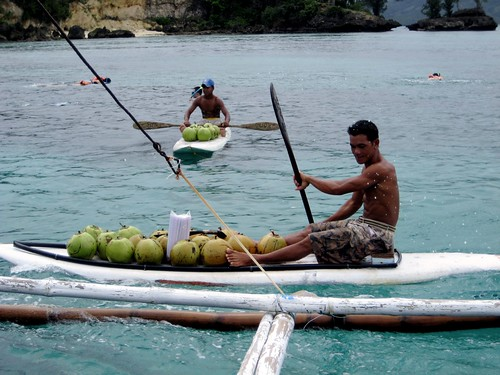 Boracay men selling coconuts, makeshift boat sea  Buhay Pinoy Philippines Filipino Pilipino  people pictures photos life Philippinen