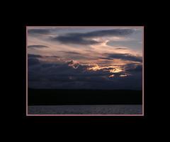 Life's Dark Cloud (MAGICHAT STUDIOS) Tags: light sunset fab sky cloud sun lake color water clouds contrast sunrise pond shadows magicmoments cloudformation rolling whisps blueribbonwinner sweetshot flickrsbest abigfave abigfav anawesomeshot superbmasterpiece superbmasterpiecegroup megashot ysplix theperfectphotographer novaphoto