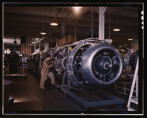 Cowling and control rods are added to motors for North American B-25 bombers as they move down the assembly line,  North A...