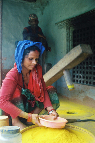 My nepali mother making saffron powder