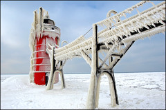 south haven light iced (Tom Gill.) Tags: winter lighthouse snow cold ice bravo michigan freezing lakemichigan greatlakes southhaven lapstrake
