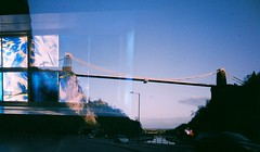 Lucky Doubles 22 (Trapac) Tags: uk bridge blue sunset england film window glass bristol lights scotland spring artgallery doubleexposure glasgow goma plasticfantastic lucky inthecar a4 expired vivitar suspensionbridge cliftonsuspensionbridge plasticcamera brunel isambardkingdombrunel galleryofmodernart 100iso avongorge wmh cumberlandbasin flickrwalk vivitarultrawideandslim theportway vivitarroll12 vivitarroll13 vivitarws luckysuper withslithytoves vivitaultrawideslim marbeld roll1213