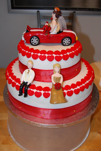 car wedding cake wedding cake with and groom in car a photo on 12425