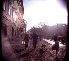 The streets of Slovenia. (dewing666) Tags: family trees winter light sunset dog holiday snow cold art love walking togetherness holga saturated couple europe european artistic creative young vivid lifestyle photographic valentine lovers lightleak explore relationship slovenia together passion valentines destination romantic holdinghands icy relationships picturesque effect spark vignette partner vignetted valentinesday punchy valentineday ljubljanica edgy walkingdog theljubljanicariver ljubljana