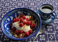 Morning Meal (MaureenShaughnessy) Tags: blue winter food cup kitchen coffee fruit breakfast java healthy ceramics coffeecup bowl homemade meal espresso woven tablecloth yogurt granola raspberries flax ikat nutritious blackpepper nourishment whatieatinthemorning sarahjaegerpottery