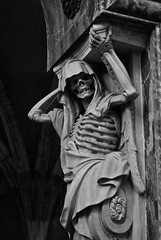 Tales from the Crypt (Pierre J.) Tags: sculpture france church statue stone skeleton skull pierre os 45 creepy explore creativecommons bones crne squelette loiret chteauneufsurloire