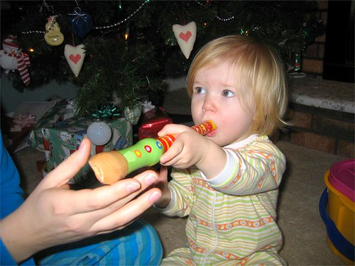 Hannah and her wooden flute on Christmas morning