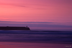 Sunset in Pink (Cameno) Tags: pink sunset sea naturaleza lighthouse seascape nature clouds d50 landscape faro mar nikon lighthouses purple rosa paisaje nubes puestadesol santander cantabria faros morado sanvicentedelabarquera