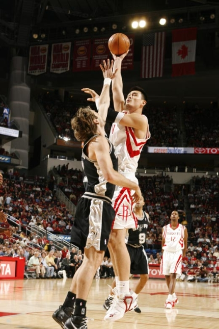 Yao Ming shoots a jump hook in the lane over San Antonio's Fabricio Oberto in a big win Tuesday night against the Spurs.  Yao scored 28 points, grabbed 13 boards, dished 6 assists and blocked 3 shots.