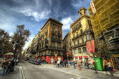 Las Ramblas Intersection (Doug Mo (Gone Vagabonding)) Tags: barcelona road travel cloud clouds spain pedestrian catalonia explore larambla pedestrians lasramblas roads photoshopcs2 ramblas 2007 rambla liceu barcelons canonefs1022mmf3545usm photomatixpro interestingness353 i500 superaplus aplusphoto goldenphotographer dougmo shadowcaster57
