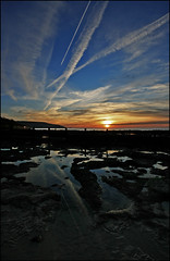 Flightpath - Contrails over Totland Bay, Isle of Wight (s0ulsurfing) Tags: ocean blue light sunset shadow sea sky cloud sun sunlight seascape reflection texture beach nature water pool weather silhouette rock clouds plane wow reflections island evening bay coast twilight sand rocks exposure skies contrail sundown natural bright dusk stones patterns wide shoreline trails silhouettes wideangle pebbles aeroplane coastal pools shore vectis isleofwight coastline ripples grad 2008 contrails isle groyne tidepool wight headland flightpath 10mm totland sigma1020 totlandbay s0ulsurfing flickrplatinum