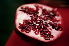 half of a pomegranate (massdistraction) Tags: red fruit juicy yummy pomegranate redrule produce fruity fruitveg seedy reallyred halved simplepleasures