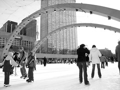 skaters (photoluver1) Tags: winter people blackandwhite bw snow toronto black ice beauty architecture children grey skyscrapers candid seasonal cities streetphotography photojournalism cityscapes winterwonderland streetphotograpghy