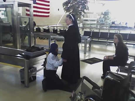 Airport security patting down nun because she doesn't have a Clear airport security card