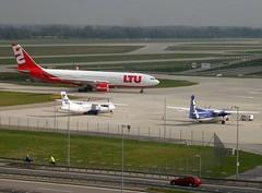 Airport Munich (MUC) ... (bayernernst) Tags: rot munich mnchen bayern deutschland airport transport september transportation flughafen muc kontrast 2007 ltu flughafenmnchen 19072007 airportmunich transportationmethods snc11160