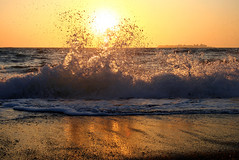 wave (esther**) Tags: light sunset summer sun sunlight reflection beach water landscape golden drops bravo mediterranean mare waves view wave greece splash topf150 topf100 seashore rhodes sunreflections anawesomeshot interestingnes3 holidaysvacanzeurlaub