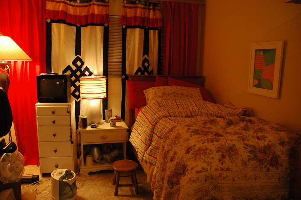My bedroom just how it is, little twin bed, Tibetan Door covers for drapes, funky covers, lamps, a tv I never ever use and all