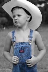 tyler (stagewestphoto) Tags: boy art boys kids cowboy texas child country rustic bandera western coveralls countryboy texascowboy banderatexas littlecowboy texasboy cowboyart southernboy rusticart rusticphoto rusticwestern southernchild rustictexas