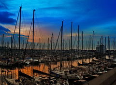 Port Olimpic. Barcelona.- (ancama_99(toni)) Tags: ocean barcelona street leica city trip travel sunset sea vacation sky urban espaa sun holiday seascape color building beach nature water architecture clouds port marina sunrise buildings landscape puerto atardecer lumix photography mar photo interestingness interesting spain agua espanha europa europe heaven mediterraneo waves cityscape seascapes photos harbour cityscapes playa cel catalonia panasonic explore amanecer ciel cielo catalunya espagne ocaso catalua pasoscatalans marinas marenostrum 35faves fz7 dmcfz7 25faves abigfave aplusphoto holidaysvacanzeurlaub superbmasterpiece ancama99 interesantsimo goldstaraward