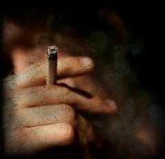 scratch (death and gravity) Tags: blur texture face self dark lightandshadows dof hand smoking scratch 2b onblack aod