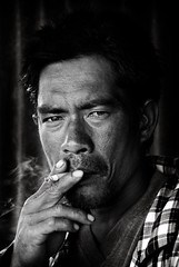 BoatMan (wazari) Tags: travel portrait blackandwhite man monochrome face look eyes nikon emotion expression smoke journey malaysia borneo d200 sabah mabul boatman wajah potret semporna bwdreams bajau hitamputih diamondclassphotographer wazari expressi denawan