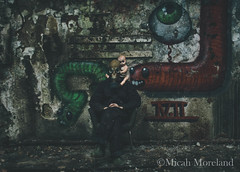 Family Portrait (micahmoreland) Tags: creepy horror surreal surrealism surrealist conceptual costume world war 2 ii dystopian scary haunting grunge texture male toxic death gas mask baby doll child urbex abandoned machine shop urban exploration