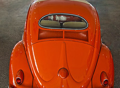 The Great Pumpkin (oybay©) Tags: vw volkswagen beetle volkswagenbeetle vwbug vwbeetle car automobile photoshop nokidding phoenixarizona 19thavenue flying airplane evelknievel herbiethelovebug herbie color colors fly cannonshot orange rust blue bluesky opticalillusion donaldtrump trump vehicle
