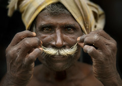 Man curling his moustache, India (Eric Lafforgue) Tags: india man face soldier democracy hands moustache indie indi indien hind indi inde hodu southasia indland  hindistan indija   ndia hindustan   lafforgue   ericlafforgue hindia  bhrat cooolie 702991  indhiya bhratavarsha bhratadesha bharatadeshamu bhrrowtbaurshow  hndkastan