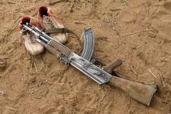 Meet The Janjaweed-08.jpg (Andrew Carter) Tags: shoes gun fighter sudan rifle sneakers trainers arab conflict militia darfur janjaweed unreportedworld