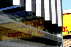 hinter gitter - behind perforated metal plate (~shrewd~) Tags: guesswherevienna wien vienna austria österreich obstgemüse obst gemüse yellow red blue gelb rot blau canon eos 300d canoneos300d geotagged geo:tool=yuancc geo:lat=48180384 geo:lon=16333001 meidling meidlinger markt tivoli sultan marktstand standl perforated metal lochblech building gebäude architektur architecture haus house urban architectur stadt town city verbaut