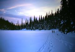 Poland Lake Snowshoe (justb) Tags: trees winter sunset lake snow tree film ice clouds snowshoe colorful glow bc snowy tracks poland scene velvia fujifilm glowing snowshoeing icy manningpark wintry blueribbonwinner justb justinbrown