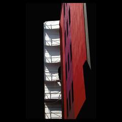 work in progress (rita vita finzi) Tags: buildings perfect carlton photographer graphic abstraction ferrara soe contrasts onblack the blackred astract blueribbonwinner firstquality flickrsbest mywinners impressedbeauty superbmasterpiece diamondclassphotographer overtheexcellence goldstaraward