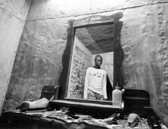 Barber,Mali (Mark William Brunner) Tags: street blackandwhite man reflection sahara portraits canon mirror barbershop barber westafrica mali timbuctou markbrunner bestbarbershop