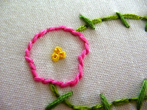 three yellow french knots...