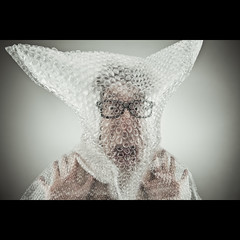 497/730: The boy in the bubble(wrap) (Mr. Flibble) Tags: nerd glasses idiot bubbles pop bubble packaging breathe bubblewrap breathing suffocate 730 suffocation flibble idrinkleadpaint