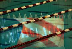 America (Polimom) Tags: reflection flag diagonal swimmingpool inverted laneropes