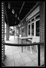 / Triptolemos Evrychou club (-Filippos-) Tags: old bw coffee shop mono chairs wide cyprus sigma flags tables 1735mm        92007  evrychou