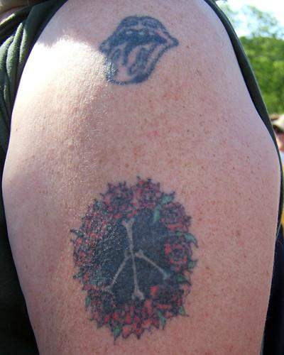 """Bones"" Peace Sign Tattoo"
