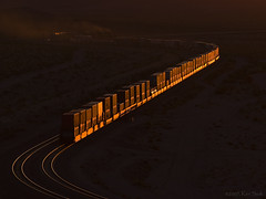 Westbound Glint (K-Szok-Photography) Tags: california canon outdoors lowlight desert trains ludlow socal mojave transportation canondslr bnsf railroads canon70200f4l alltrains movingtrains diamondclassphotographer flickrdiamond deserttrains danceswithlight sbcusa goldendiamondblog aphotographersnature kenszok