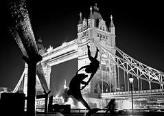 Girl and dolphin statue in front of Tower Bridge at night (ho_hokus) Tags: uk england blackandwhite bw london night towerbridge unitedkingdom riverthames blueribbonwinner girlanddolphinstatue