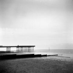 Fleetwood Pier (mojo_black) Tags: sea beach square mono coast pier holga lofi lancashire hp5 ilford fleetwood dec07 id1111
