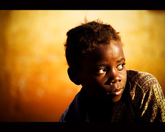 Boy In The Yellow Sun (gunnisal) Tags: world africa street portrait people boys colors child faces candid mozambique olympuse500 35faves artlibre anawesomeshot colorphotoaward aplusphoto diamondclassphotographer artlibres betterthangood ostrellina elitechildimages