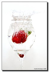 Project: Strawberry #2 (Fraggle Red) Tags: red white green water glass fruit strawberry raw flash splash onwhite firsttry eow freezemotion supershot canonefs1785mmf456isusm flickrsbest mywinners adobelighroom canonspeedlite420ex anawesomeshot diamondclassphotographer flickrdiamond