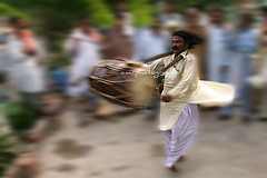 Drum Beater In Motion (Amir Mukhtar Mughal | www.amirmukhtar.com) Tags: pakistan people motion game canon circle drum culture amir beat beating beater circling faisalabad amirphotography